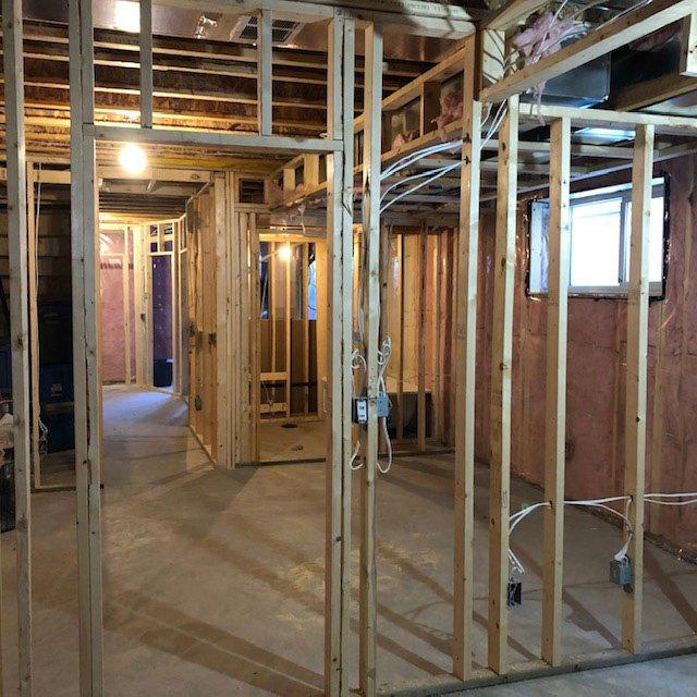 Framing stage of basement development by Ingram Renovations