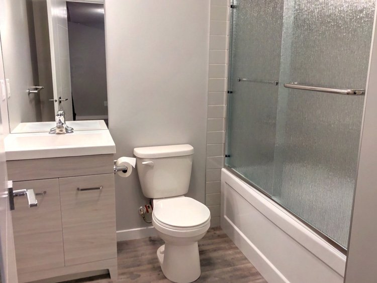 Full bath with tub & shower, sink, toilet for a Basement Development by Ingram Renovations